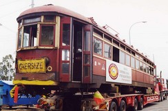 The tram being transported to our workshop
